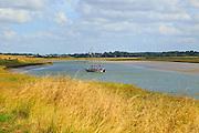 Butley Creek river landscape, Boyton, Suffolk, England, UK yacht at moorings