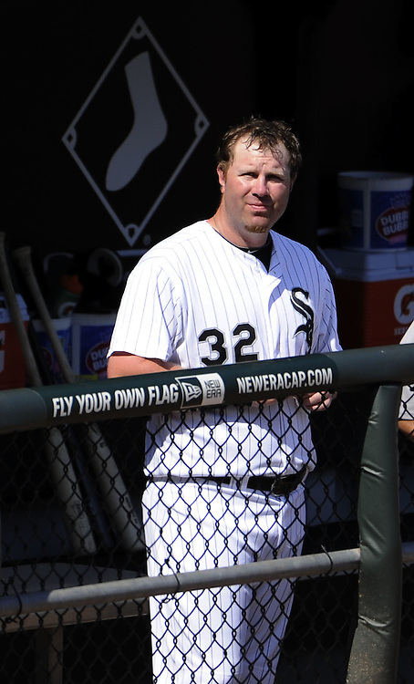 CHICAGO, IL - JUNE 26:  Adam Dunn #32 of the Chicago White Sox looks on from the dugout after striking out against the Washington Nationals on June 26, 2011 at U.S. Cellular Field in Chicago, Illinois.  The Nationals defeated the White Sox 2-1.  (Photo by Ron Vesely/MLB Photos via Getty Images)  *** Local Caption *** Adam Dunn