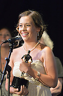 """Bellmore, New York, USA. July 21, 2016. ROSALIE DEVEREAUX GAFFNEY - the writer, producer and director of the movie short """"En Pointe"""" - accepts trophy for Best Student Film, which tied with the short film Un-Sexy, at the19th Annual Long Island International Film Expo Awards Ceremony, LIIFE 2016, held at the historic Bellmore Movies. Actor KEVIN BROWN (Dot Com in 30 Rock) once again was host. """"En Pointe"""" made its New York debut at LIIFE. LIIFE was called one of the 25 Coolest Film Festivals in the World by MovieMaker Magazine."""