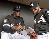 GLENDALE, ARIZONA - MARCH 02:  First base coach Daryl Boston #8 goes over outfield  defensive positioning with Luis Gonzalez #89 of the Chicago White Sox prior to the game against the Colorado Rockies on March 2, 2019 at Camelback Ranch in Glendale Arizona.  (Photo by Ron Vesely)  Subject:  Daryl Boston; Luis Gonzalez
