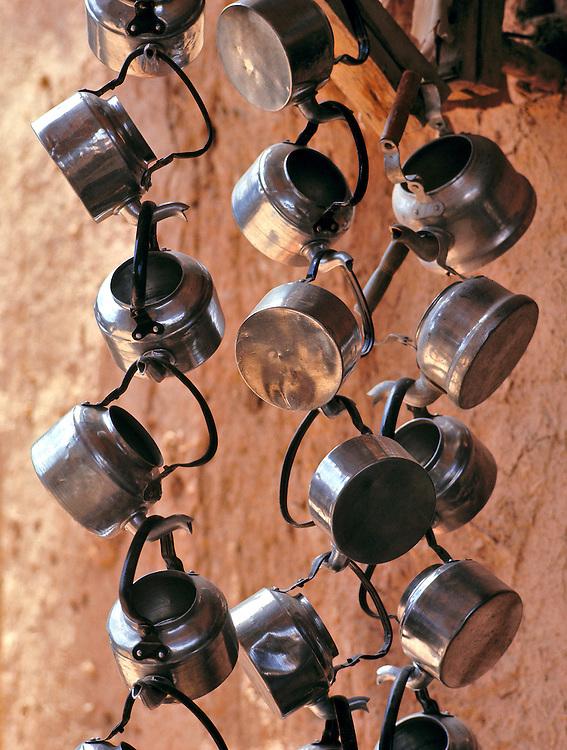 Metal teapots create an artistic display at a tea stall in the bazaar of Tashkurghan, Afghanistan.