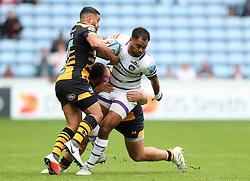 Leicester Tigers' Telusa Veainu is tackled by Wasps' Lima Sopoaga and Kieran Brookes during the Gallagher Premiership match at The Ricoh Arena, Coventry