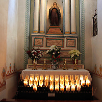 USA, California, Oceanside. Altar and candles at Old Mission San Luis Rey de Francia.