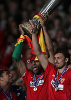 Photo: Paul Thomas.<br /> Espanyol v Sevilla. UEFA Cup Final. 16/05/2007.<br /> <br /> Frederic Kanoute of Sevilla holds up the trophy with captain Javi Mavarro (R).