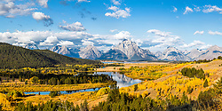 """The famous Oxbow Bend of the Snake River from above. Autumn is an amazing time to photograph the splendor of the golden aspen that sprout prodigiously around the river. The traditional place to shoot the Oxbow is along the river, this mountain above provides a fresh angle on this iconic spot.<br /> <br /> This is a large file and can be printed at a 2X1 crop, six feet wide at 150dpi.<br /> <br /> For production prints or stock photos click the Purchase Print/License Photo Button in upper Right; for Fine Art """"Custom Prints"""" contact Daryl - 208-709-3250 or dh@greater-yellowstone.com"""