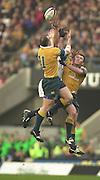 Twickenham, England, Autumn International. RFU Twickenham Stadium<br /> 16/11/2002<br /> International Rugby - England vs Australia.<br /> Jaason Robinson flanked by Australins defender redirects the high ball.         [Mandatory Credit:Peter SPURRIER/Intersport Images]