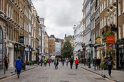 © Licensed to London News Pictures. 25/11/2020. London, UK. People out on the street in a quiet Covent Garden in central London. The government has announced that tiered restrictions will be reintroduced when the England-wide lockdown ends on 2 December. Photo credit: Rob Pinney/LNP