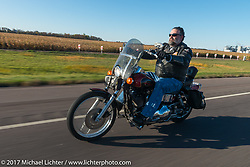 City of Groton, SD Council Member David Blackmun riding his Harley-Davidson in the USS South Dakota submarine flag relay across South Dakota. Groton, SD. USA. Sunday October 8, 2017. Photography ©2017 Michael Lichter.