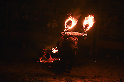 November 11, 2018 - Medinaceli, Spain - A fire bull stands on the arena during the 'Toro de Jubilo' Fire Bull Festival in Medinaceli. 'Toro de Jubilo' is an ancient tradition from the bronze age held annually at midnight in the Spanish town of Medinaceli. During the event a bull, which is covered with a thick layer of mud on the back and face to protect it from burns, is tied to a pylon and set on fire before the animal released. After, revelers dodge the bull when it comes close until the flammable material is consumed. (Credit Image: © John Milner/SOPA Images via ZUMA Wire)