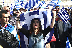 February 5, 2018 - Athens, Syntagma square, Greece - A protester holds a Greek flag in front of the Parliament during a rally in Athens..Rally against the use of the term ''Macedonia'' in any settlement to a dispute between Athens and Skopje over the former Yugoslav republic's name. (Credit Image: © Christos Ntountoumis/SOPA via ZUMA Wire)