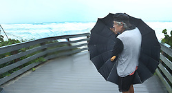 In about 40 mph winds, Patrick Danver, 67, of Satellite Beach, FL, USA. uses an umbrella to shield himself from the driving rain on Sunday, September 10, 2017 as Hurricane Irma made landfall in the state of Florida. Photo by Red Huber/Orlando Sentinel/TNS/ABACAPRESS.COM