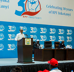 KIGALI, Dec. 14, 2017  Rwandan President Paul Kagame (1st L), who is also the chairman of Rwanda's ruling party Rwandan Patriotic Front (RPF), delivers remarks at the opening ceremony of a national congress of RPF in Kigali, capital of Rwanda, on Dec. 14, 2017. The three-day national congress organized by the Rwandan Patriotic Front (RPF) opened Thursday at the party headquarters in Kigali, as part of activities to mark the 30th anniversary of the party's establishment. (Credit Image: © T. Kisambira/Xinhua via ZUMA Wire)