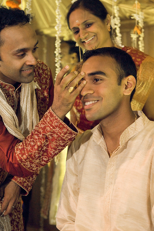 Applying tikka put on a South Indian Groom during a Tamil Brahmin Wedding