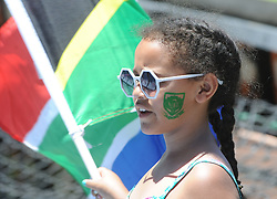 Pretoria 26-12-18. The 1st of three 5 day cricket Tests, South Africa vs Pakistan at SuperSport Park, Centurion. Day 1. Jaime Theys(6) from Primrose, Johannesburg waves a South African flags in the heat of the day as temperatures soared to around 35deg Celcius.<br /> Picture: Karen Sandison/African News Agency(ANA)<br /> <br /> Picture: Karen Sandison/African News Agency(ANA)