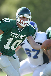 15 September 2007:  Kraig Ladd extends the ball to an approaching running back. The Titans stood toe to toe with the 25th ranked Lions through the first half but ended the game on the losing end of a 25-15 score at Wilder Field on the campus of Illinois Wesleyan University in Bloomington Illinois.
