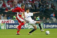 Photo: Chris Ratcliffe.<br /> Middlesbrough v Sevilla. UEFA Cup Final. 10/05/2006.<br /> Middlesbrough's Franck Queudrue tussles with Sevilla's Marti.