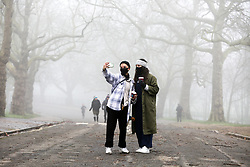 © Licensed to London News Pictures. 28/12/2020. London, UK. Celiac (L) and Luna (R) wearing face coverings take a selfie with dense freezing fog in Finsbury Park, north London as many parts of the UK wakes to further freezing temperatures. Photo credit: Dinendra Haria/LNP