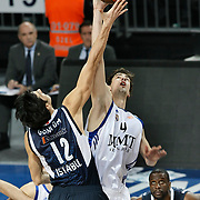 Efes Pilsen's Flip MURRAY (R) and Real Madrid's Ante TOMIC (C) during their Turkish Airlines Euroleague Basketball Top 16 Group G Game 4 match Efes Pilsen between Real Madrid at Sinan Erdem Arena in Istanbul, Turkey, Thursday, February 17, 2011. Photo by TURKPIX