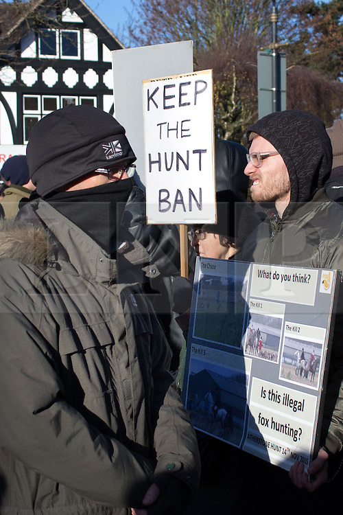 © Licensed to London News Pictures. 2/1/2016. Atherstone, North Warwickshire, UK. The annual New Year meet of the Atherstone Hunt took place in the market square earlier today. Anti-Hunt protesters were also in the square and the Police were called after scuffles broke out during the meet. A police helicopter monitored the situation as the protestors sought sanctuary in a nearby car park, whilst waiting for the arrival of Police on foot. Protestors in the Market Square. Photo credit: Dave Warren/LNP