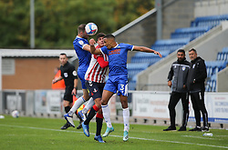 Tommy Smith of Colchester United and Cohen Bramall of Colchester United sandwich Sido Jombati of Oldham Athletic - Mandatory by-line: Arron Gent/JMP - 03/10/2020 - FOOTBALL - JobServe Community Stadium - Colchester, England - Colchester United v Oldham Athletic - Sky Bet League Two