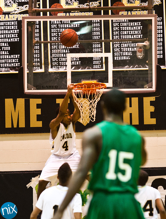 Concord's Jacquise Moore misses a dunk against Kannapolis Friday night at Concord High School. Concord won the game 77-51 to finish the season on top of the South Piedmont Conference. The SPC tournament starts next week. (Photo by James Nix)