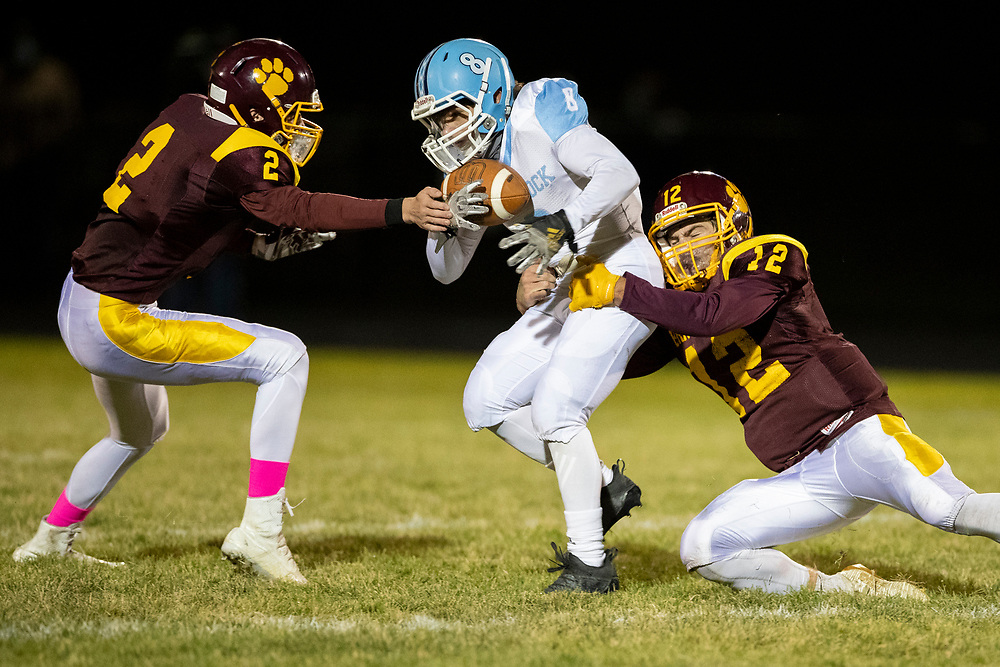 Comstock's Owen Drake runs with the ball after the catch as Brandywine defenders attempt to make the tackle during the Comstock-Brandywine high school football game on Friday, October 30, 2020, at Selge Field in Niles, Michigan.