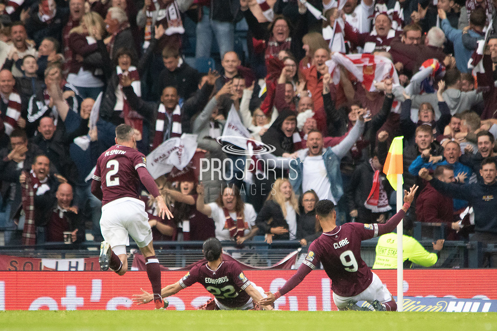Michael Smith, Ryan Edwards & Sean Clare of Hearts celebrate in front of their fans during the William Hill Scottish Cup Final match between Heart of Midlothian and Celtic at Hampden Park, Glasgow, United Kingdom on 25 May 2019.