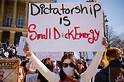 06 MARCH 2021 - DES MOINES, IOWA: A member of Iowa's Burmese community holds a sign protesting the coup in Myanmar. About 300 members of the Burmese community in Iowa gathered at the State Capitol in Des Moines Saturday to protest against the military coup that deposed the popularly elected government of Aung San Suu Kyi and continuing military oppression in Myanmar. There are about 10,000 people in Iowa's Burmese community.          PHOTO BY JACK KURTZ