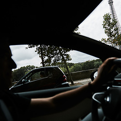 Laurens Van Den Acker, Chief Designer at Groupe Renault, driving in Paris toward Ile Seguin. Boulogne-Billancourt, France. July 27, 2019.