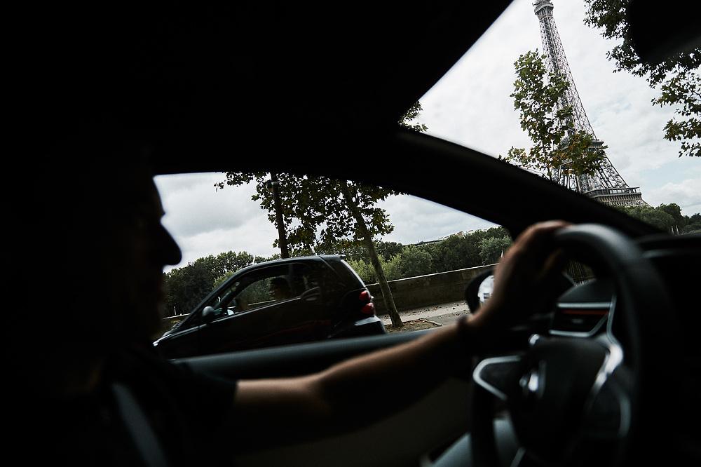 Laurens Van Den Acker, Chief Designer at Groupe Renault, driving in Paris toward Ile Seguin. Boulogne-Billancourt, France. July 27, 2019.