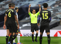 Football - 2020 /2021 Premier League - Tottenham Hotspur vs Newcastle United<br /> <br /> Referee, Peter Bankes tells players he is checking for a possible penalty in injury time, at the Tottenham Hotspur Stadium.<br /> <br /> COLORSPORT/ANDREW COWIE