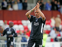 Photo: Andrew Unwin.<br />Hartlepool Utd v Swansea. Coca Cola League 1.<br />17/09/2005.<br />Swansea's Lee Trundle applauds the away-fans at the end of the game.