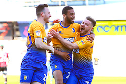 CJ Hamilton of Mansfield Town celebrates his goal with Gethin Jones of Mansfield Town and Krystian Pearce of Mansfield Town - Mandatory by-line: Ryan Crockett/JMP - 19/04/2019 - FOOTBALL - One Call Stadium - Mansfield, England - Mansfield Town v Morecambe - Sky Bet League Two