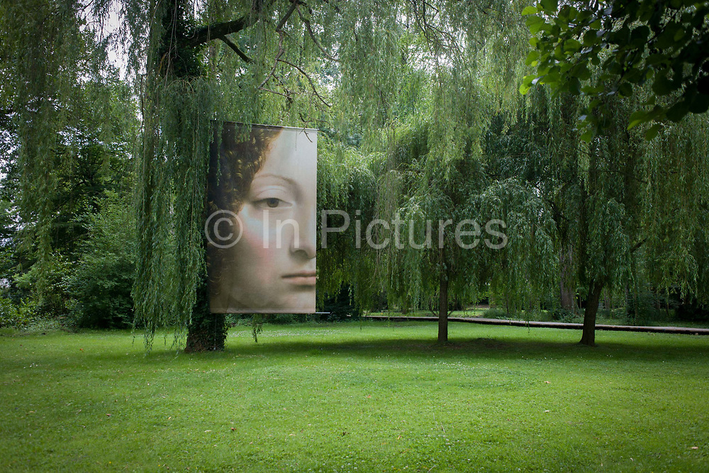 The face of 'Ginevra de' Benci' in the gardens of at Chateau de Clos Lucé, home to Leonardo da Vinci for the last 3 years of his life and now a celebration of his life and achievements, Amboise, France. Ginevra de' Benci (born c.1458) was an aristocrat from fifteenth-century Florence, admired for her intelligence by Florentine contemporaries. She is the subject of a portrait painting by Leonardo da Vinci. The oil-on-wood portrait was acquired by the National Gallery of Art in Washington, D.C., United States, in 1967, for US$5 million. Here, a cropped version shows her among the natural beauty of da Vinci's French home gardens. Da Vinci lived here until his death in 1519.