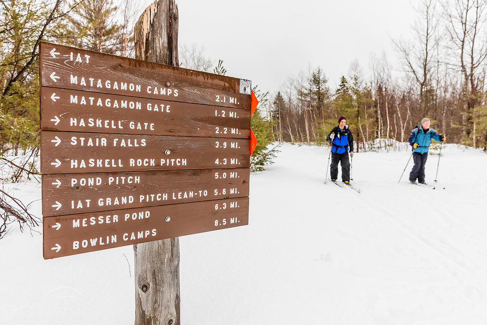 Two men cross-country skiing in Maine's Katahdin Woods and Waters National Monument.