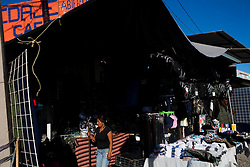 Many shops in Altar, Sonora sell goods that migrants need on their journey, like backpacks, hydration salts and matches.  Altar is the starting point for many migrants' journeys to the US. In Altar they find guides and coyotes to take them across the border.  The town's economy is nearly entirely dependent on the migrants. Recently drug cartels have become involced in the smuggling of people, using the same routes as the drugs and charging the migrants an exit tax to leave the country.
