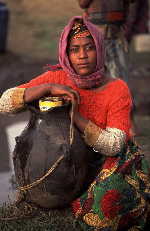 Woman with water pot Ethiopia<br /> <br /> Pic Steve Morgan