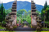 Bali, Tabanan, Batukau. The Pura Luhur Batukau temple sits on the slopes of Gunung Batukau. The main entrance to  is a split gate.