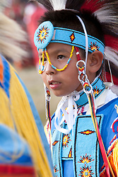 North America, United States, Washington, Seattle, boy in traditional regalia dancing at powwow