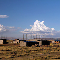 South America, Peru, Lake Titicaca. Construction of a village nearby Lake Titicaca.