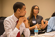Purchase, NY – 31 October 2014. Early College High School student  Daniel Meed, left, listens to teammate Jamely Marte. The Business Skills Olympics was founded by the African American Men of Westchester, is sponsored and facilitated by Morgan Stanley, and is open to high school teams in Westchester County.