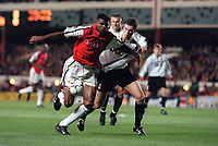 Kanu (Arsenal) Dainius Gleveckas (FC Shakhar Donetsk). Arsenal 3:2 FC Shakhar Donetsk, UEFA Champions League, Group B, 20/9/2000. Credit Colorsport / Paul Roberts.