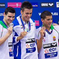 Silver medalist Gergo Kis (L) of Hungary, gold medalist Gregorio Paltrinieri (C) of Italy and bronze medalist Gergey Gyurta (R) of Hungary celebrate their victory in the Men's 1500m Freestyle final of the 31th European Swimming Championships in Debrecen, Hungary on May 23, 2012. ATTILA VOLGYI