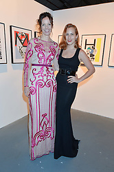 Left to right, BRITA FERNANDEZ-SCHMIDT and CHARLOTTE OLYMPIA DELLAL at the Women for Women International Catwalk Show & Auction in partnership with Brown's and sponsored by Swarovski held at The Vinyl Factory, Brewer Street Space, Brewer Street, London on 20th November 2014.