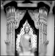 A Buddha decorates a temple in Chaing Mai, Thailand.