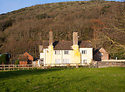 Exmoor farmhouse set amongst trees in Allerford hamlet, Selworthy, Somerset, England