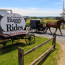 Strasburg, PA- May 29, 2016: Buggy Rides sign includes an actual Amish buggy near Strasburg, in Lancaster County PA.