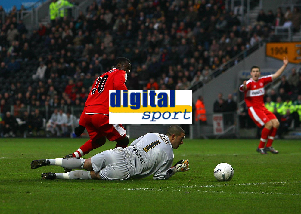 Photo: Andrew Unwin.<br />Hull City v Middlesbrough. The FA Cup. 06/01/2007.<br />Middlesbrough's Yakubu rounds Hull's goalkeeper, Bo Myhill, but is denied by a defender.