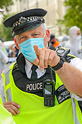 A Police officer (C) is pointing a finger towards a photographer asking their officers to remove members of the press from the protestors' scene. The officer who was subsequently seen attempting to obstruct members of the 'crime scene' investigation unit of Extinction Rebellion, also asked his men to obstruct members of the press meanwhile protestors were delivering a performative crime scene protest seeking to step up pressure on Shell and demand an end on fossil fuel extraction as well as ecocide, outside SHell Headquarters in Jubilee Gardens, central London on Tuesday, Sept 8, 2020. Environmental nonviolent activists group Extinction Rebellion enters its 8th day of continuous ten days protests to disrupt political institutions throughout peaceful actions swarming central London into a standoff, demanding that central government obeys and delivers Climate Emergency bill. (VXP Photo/ Vudi Xhymshiti)