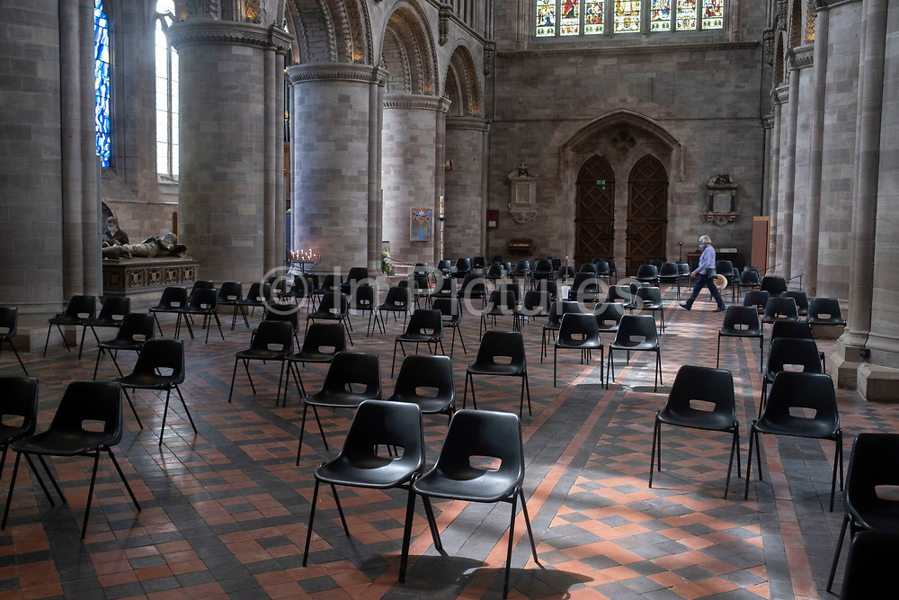 Interior view of seating for social distancing in Hereford Cathedral on 7th June 2021 in Hereford, United Kingdom. Hereford Cathedral is the cathedral church of the Anglican Diocese of Hereford, England. A place of worship has existed on the site of the present building since the 8th century or earlier. The present building was begun in 1079. Substantial parts of the building date from both the Norman and the Gothic periods.